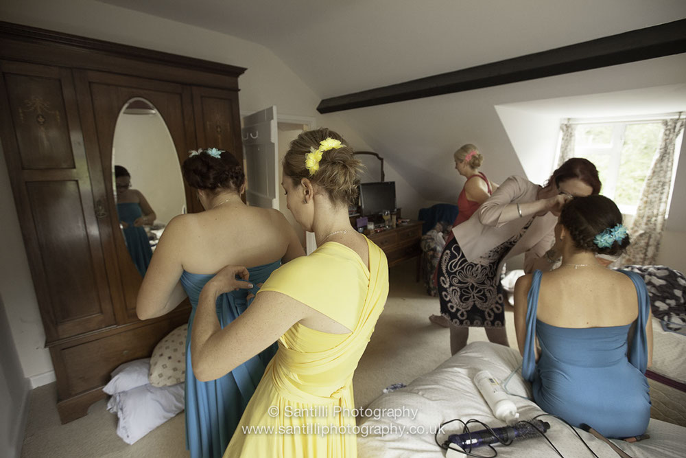 The maid of honour and bridemaids getting ready in their very colourful dresses.