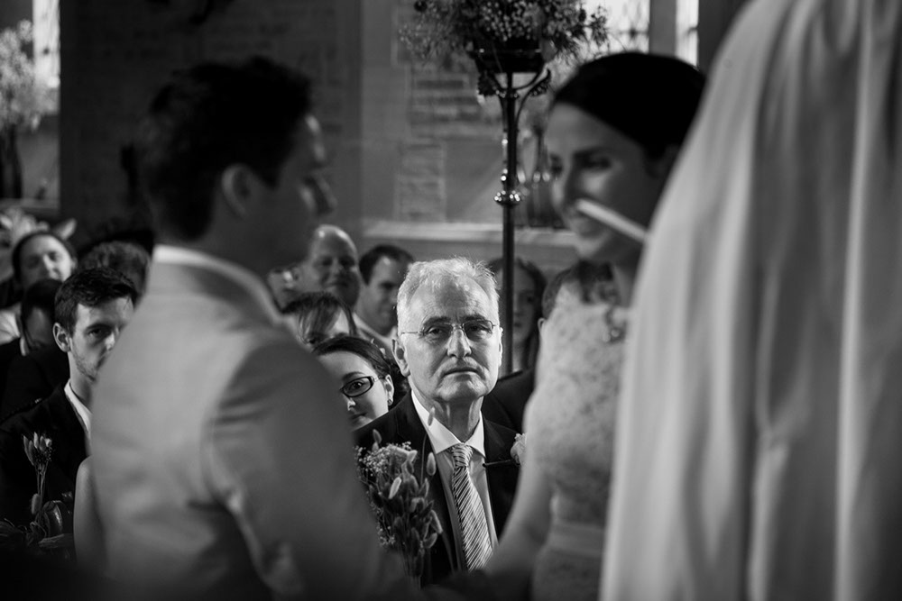 A very proud father of the bride looking on as the wedding couple say their vows.